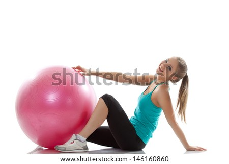 Image of cheerful young athlete posing with ball - stock photo
