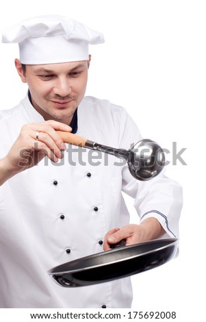 image of chef prepares in pan on white background - stock photo