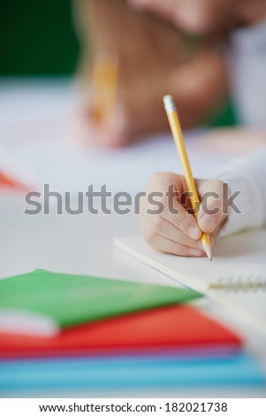 Image of child hand drawing with pencil - stock photo