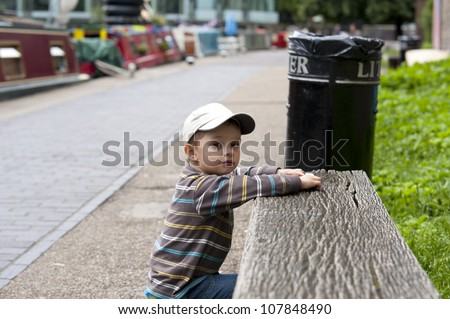 Image of child playing near the river - stock photo