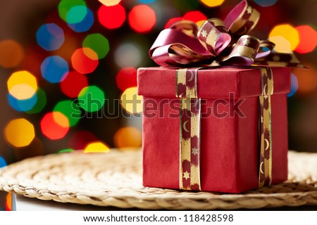 Image of Christmas giftbox on wattled tray - stock photo
