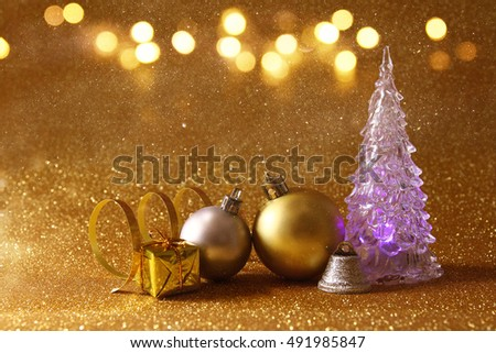 Image of christmas glowing festive tree and ball decorations on glitter background