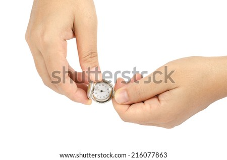 Image of clock in woman's hand isolate on white background