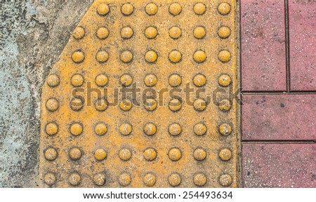 image of close up at Tactile paving texture for blind handicap on the road. - stock photo