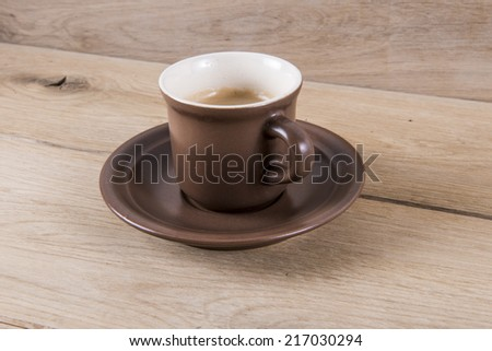 Image of coffee cup on wood background - stock photo