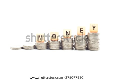 Image of  coins stacked and word MONEY over white background - stock photo