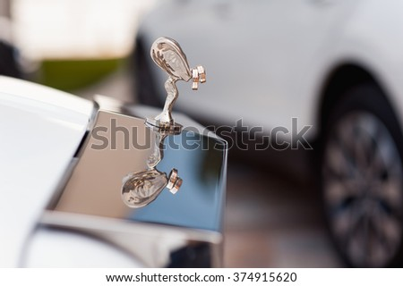 Image of cold two rings hanging on the car in front - stock photo