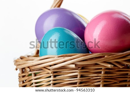 Image of colored Easter eggs in basket - stock photo