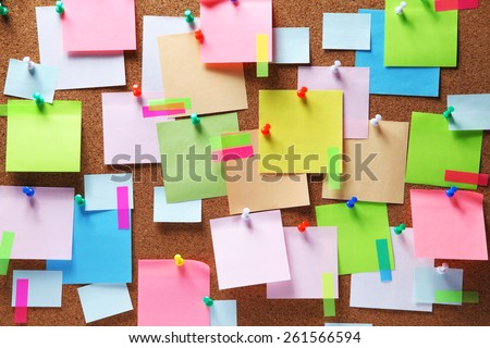 Image of colorful sticky notes on cork bulletin board - stock photo