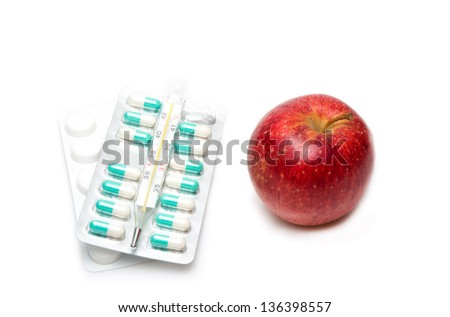 Image of composition with medicaments and apple. selective focus