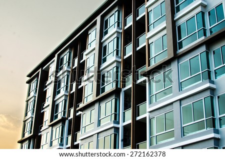 image of condo on afternoon with sun set - stock photo