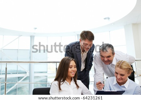 Image of confident manager showing plan to colleagues - stock photo