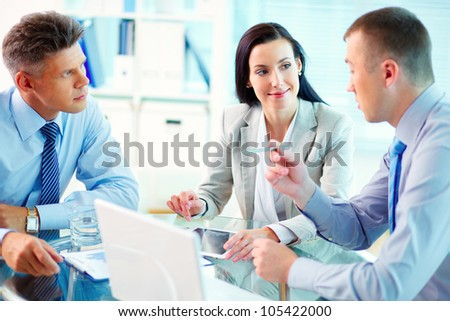 Image of confident partners interacting at meeting