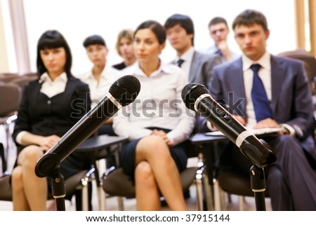 Image of confident people listening to lecture at conference