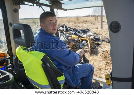 Image of Construction worker using digger - stock photo