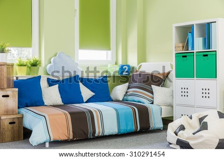 Image of contemporary style green boy room interior - stock photo
