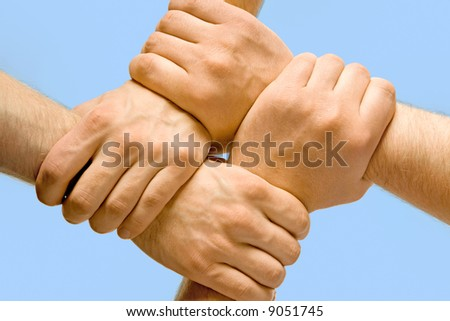Image of crossed hands isolated over blue background - stock photo