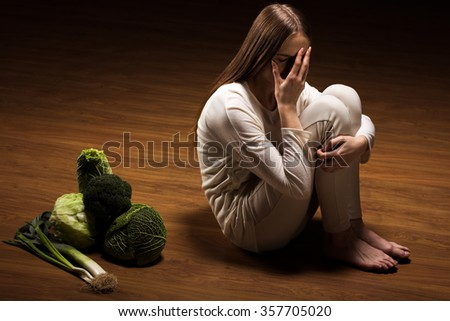 Image of crying anorexic girl rejecting food - stock photo