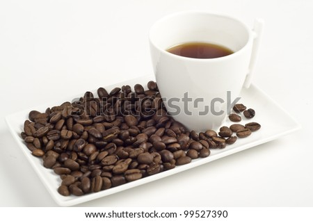 Image of cup of coffee and beans on white