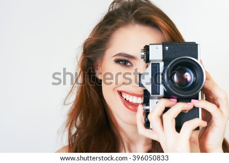 Image of cute girl make a photo selfie at vintage camera. Take a photograph of herself. Funny, party. Beauty. Happy girl smiling. Makeup and hairstyle