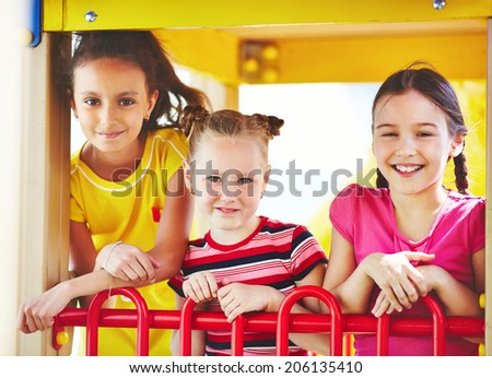 Image of cute girls spending time on playground outdoors  - stock photo