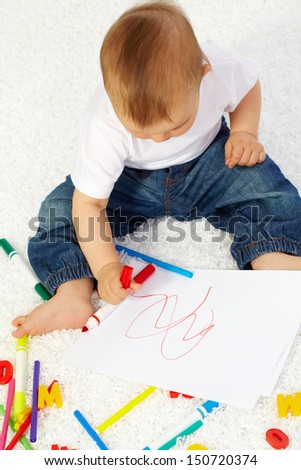 Image of cute little boy drawing with crayons - stock photo