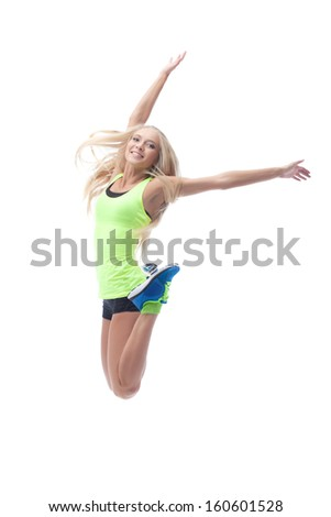 Image of cute young blonde posing in jump - stock photo