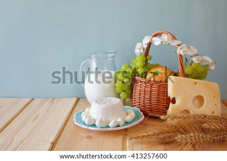 image of dairy products and fruits on wooden background. Symbols of jewish holiday - Shavuot - stock photo