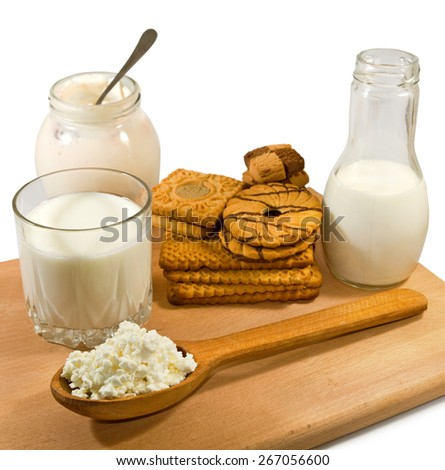 image of dairy products on a wooden board closeup