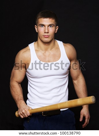 Image of dangerous man player with bat - stock photo