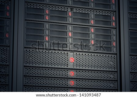 Image of data servers while working. Red LED lights are flashing. Image can represent cloud computing, information storage, etc. or can be the perfect technology background.