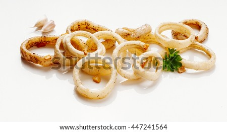 Image of delicious calamari saut�©ed in garlic to apply to label design - stock photo