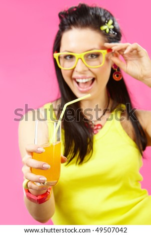 Image of delicious orange juice in female hand