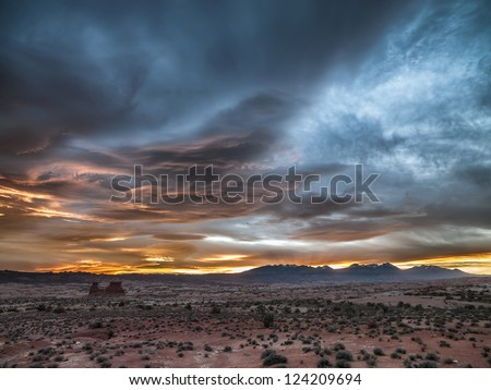 Image of deserted landscape with cloudy sky. - stock photo