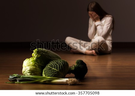 Image of despair woman suffering from eating disorder - stock photo