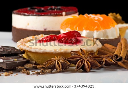Image of different delicious cakes on a black background close-up