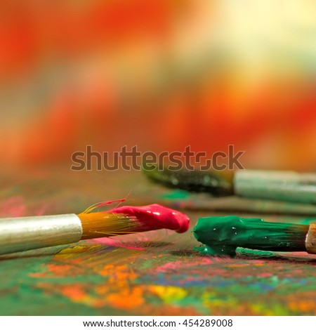 image of  different paints and three brushes close up - stock photo