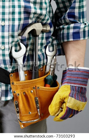 Image of different tools in pocket of repairman - stock photo