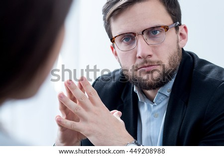 Image of doctor listening his patient with depression - stock photo