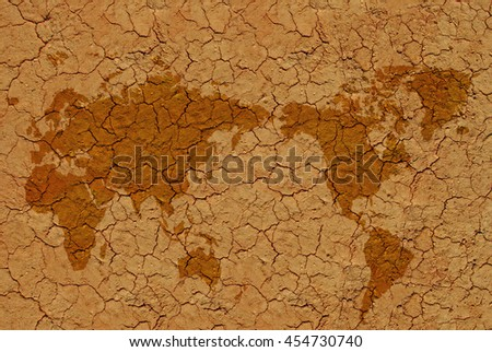 Image of dried soil with flat world map - stock photo