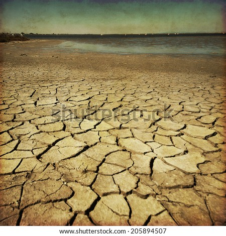 Image of drought land in grunge and retro style.