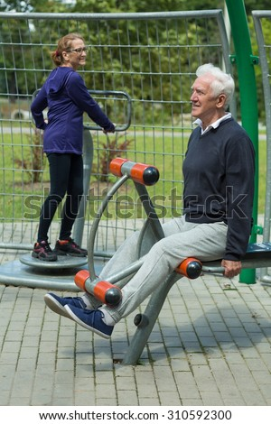 Image of elder people spending leisure time in outdoor gym - stock photo