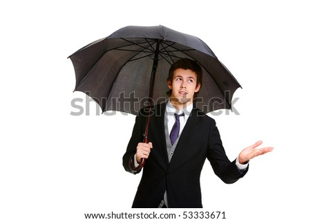 Image of elegant businessman under black umbrella - stock photo