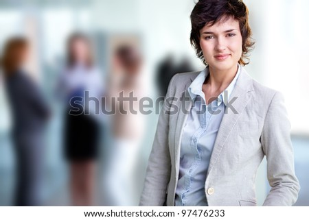 Image of elegant female looking at camera in working environment