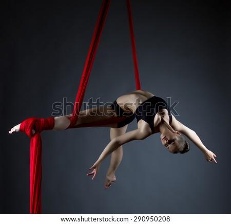 Image of elegant girl doing acrobatic trick  - stock photo