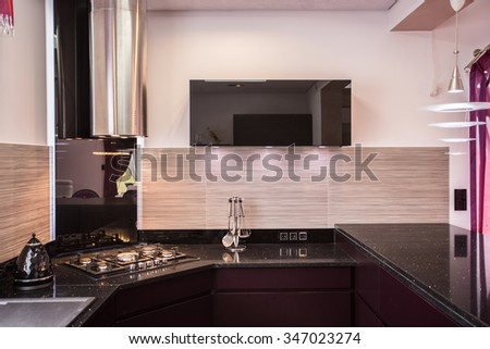 Image of elegant modern kitchen with decorative light backsplash