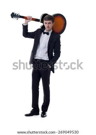 Image of elegant musician posing with guitar - stock photo