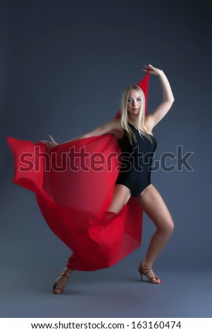 Image of emotional sexy girl dancing with cloth