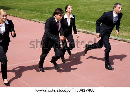 Image of employees running on sport track - stock photo