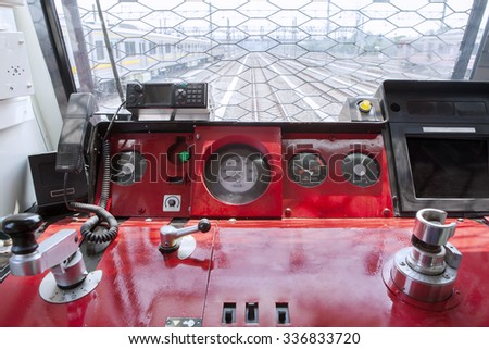 Image of empty control panel inside commuter trains, shot in the machinist room - stock photo